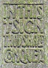 Liberty gravestone behind cross